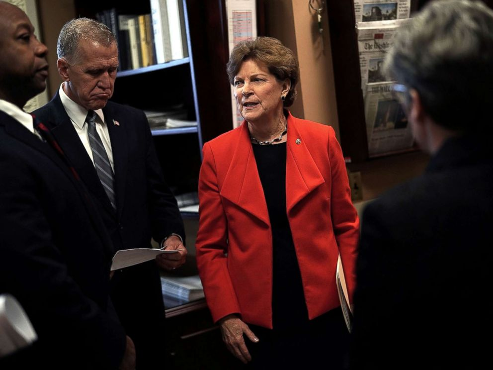 PHOTO: Sen. Jeanne Shaheen (D-NH) (R) talks to Sen. Thom Tillis (R-NC) (2nd L) and Sen. Tim Scott (R-SC) (L) prior to a news conference at the Capitol, Feb. 7, 2018.