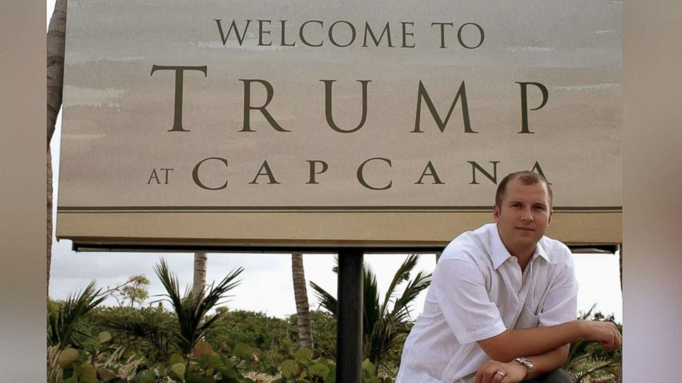 William Ganz poses in front of a sign for the original Trump Cap Cana development.