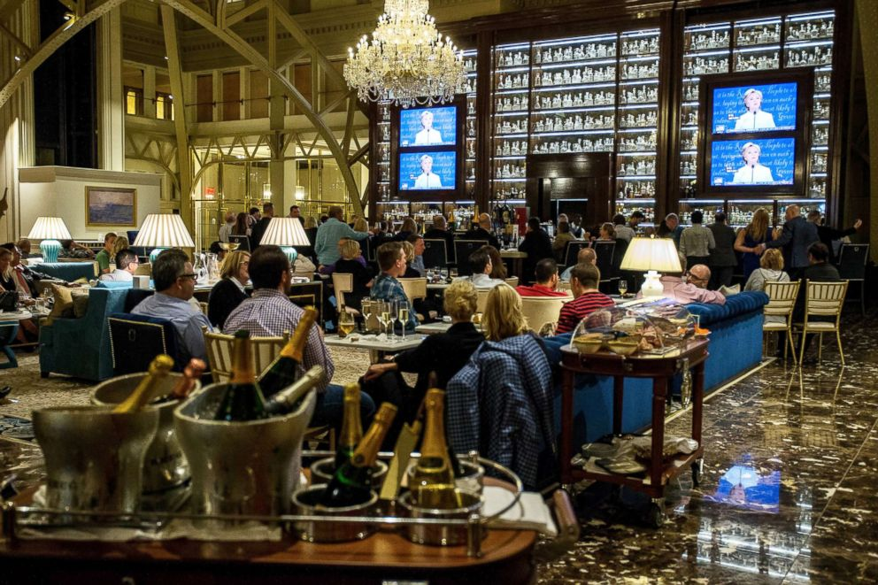 PHOTO: People watch the third presidential debate between Democratic presidential candidate Hillary Clinton and Republican presidential candidate Donald Trump at the Trump International Hotel, Oct. 19, 2016, in Washington, D.C.