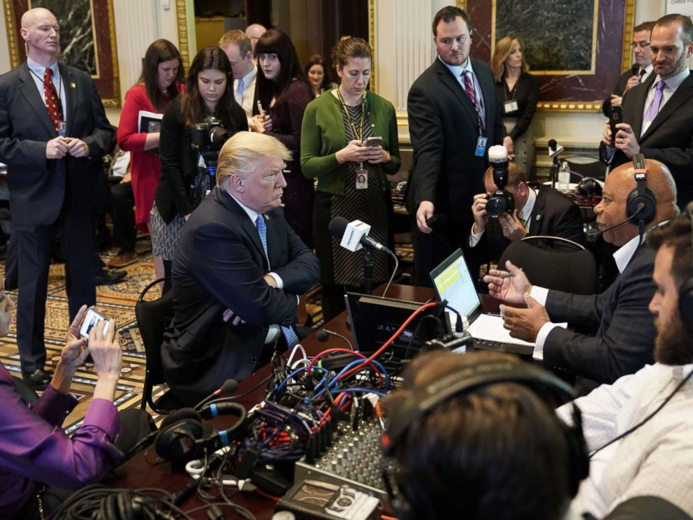 PHOTO: President Donald Trump looks at a reporter as he takes part in a series of radio interviews in the Eisenhower Executive Office Building, next to the White House, on Oct. 17, 2017 in Washington.