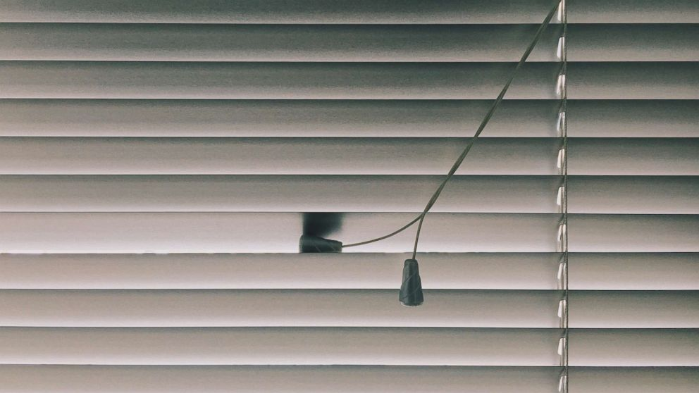 Window blinds are seen here.