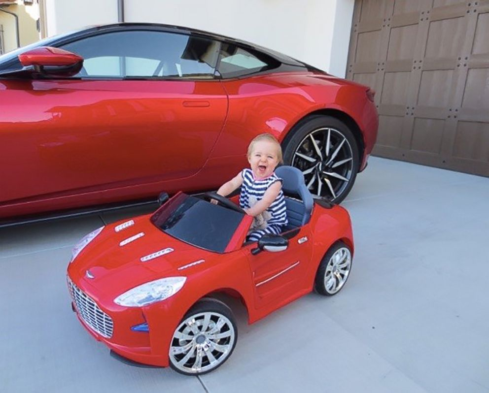 PHOTO: Laura Schwabs daughter Marie in her own mini Aston Martin.