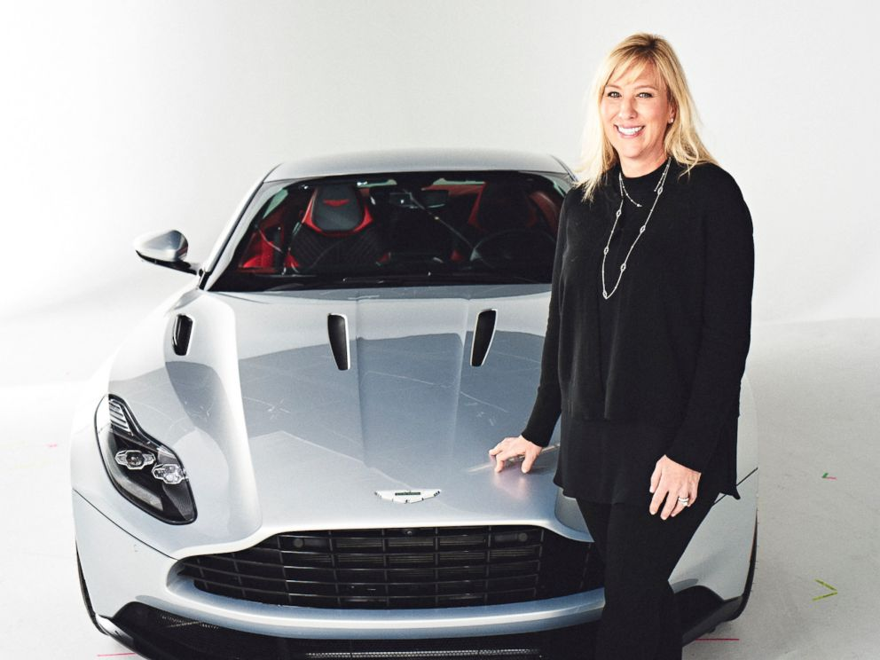 PHOTO: Laura Schwab stands next to an Aston Martin DB11.