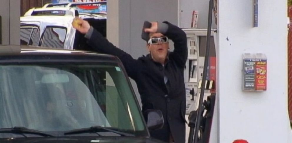 PHOTO: A driver jumps for joy as he fills his car with gas costing below $3 per gallon in Florence, Ky.