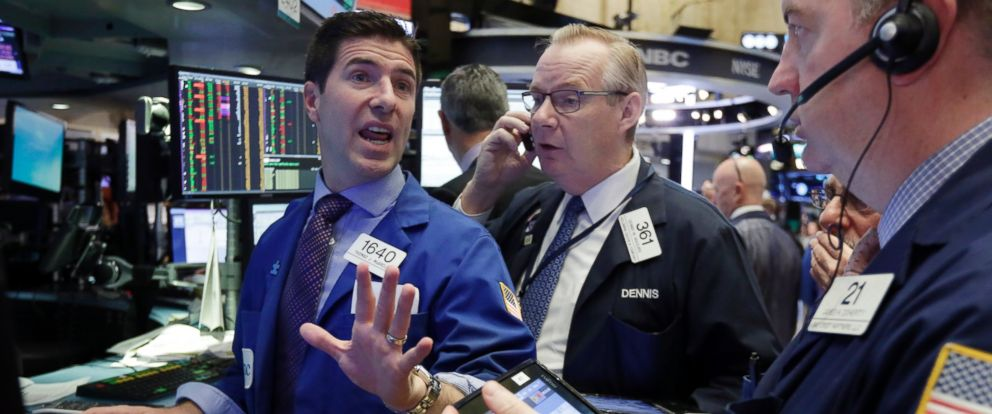PHOTO: Specialist Thomas McArdle, left, works on the floor of the New York Stock Exchange, Nov. 2, 2016. Stocks are opened lower on Wall Street as the market extends a pre-election losing streak.