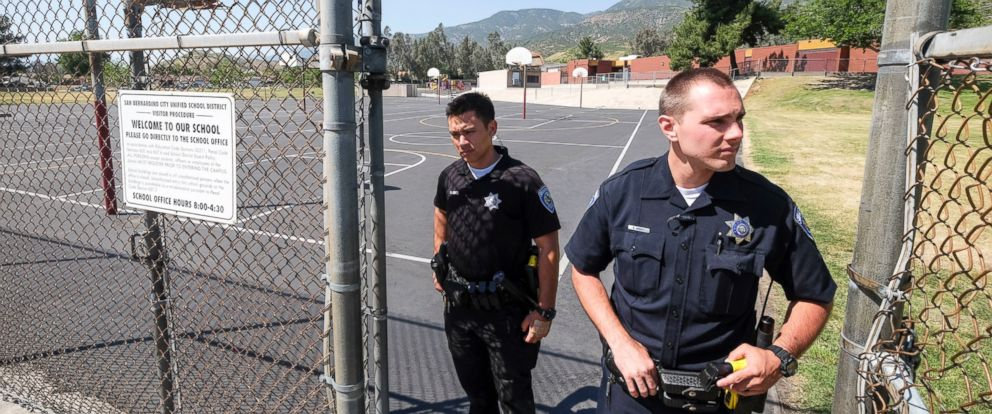PHOTO: Police officers stand guard outside North Park School after a deadly shooting, April 10, 2017, in San Bernardino, Calif.