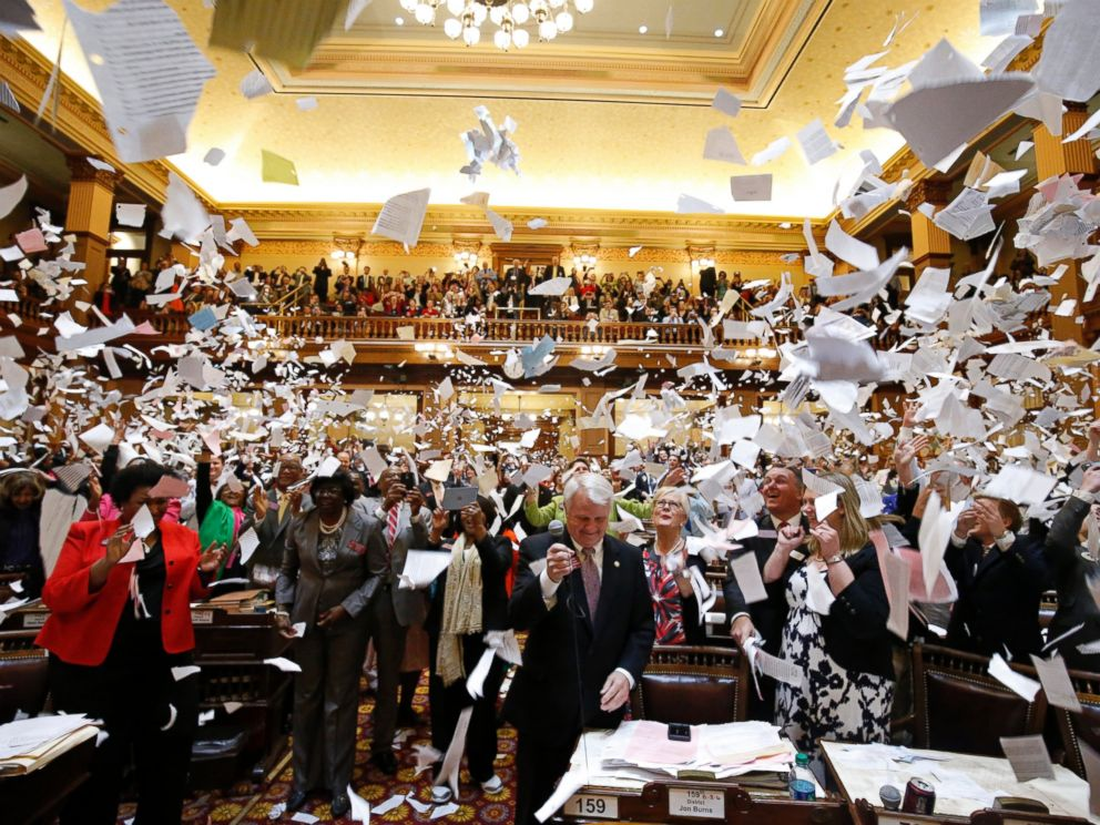 PHOTO: Representatives throw papers up in the air at the conclusion of the final day of the Georgia General Assembly at the capitol in Atlanta, March 25, 2016.