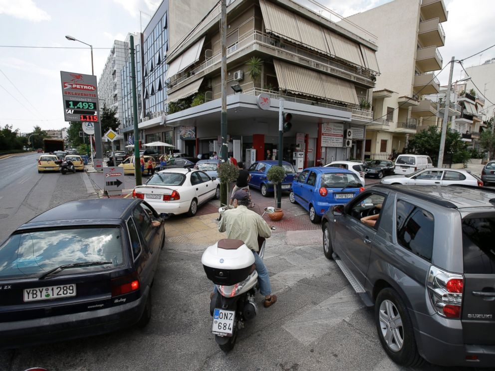 PHOTO: Drivers wait to fill their cars and scooters at a filling station, June 29, 2015, in Athens.
