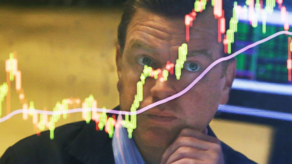 Specialist Michael O'Mara works on the floor, Aug. 25, 2015, of the New York Stock Exchange.