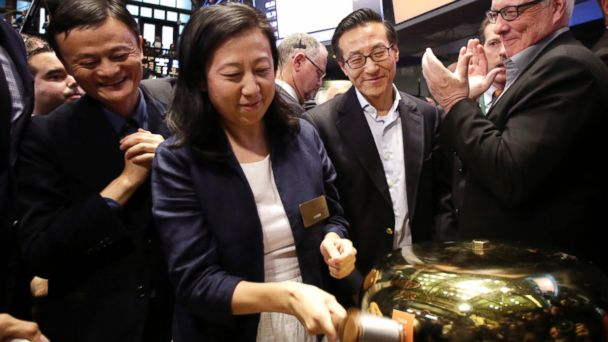 PHOTO: Chief Financial Officer of Alibaba Group Maggie Wu strikes a bell as Jack Ma, left, founder of Alibaba, watches during the companys IPO at the New York Stock Exchange, Sept. 19, 2014 in New York.