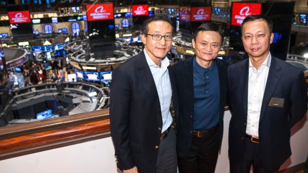 PHOTO: Alibaba founder Jack Ma, center, poses for a photograph before ringing the opening bell to celebrate his companys initial public offering, Sept. 19, 2014, in New York.