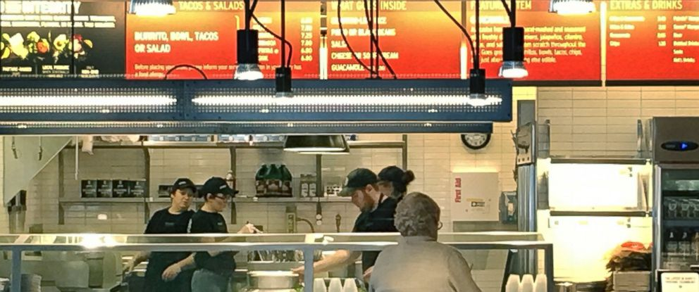 PHOTO: Workers prepare food at a Chipotle store Thursday, March 10, 2016, in Billerica, Mass., in advance of reopening later in the day.
