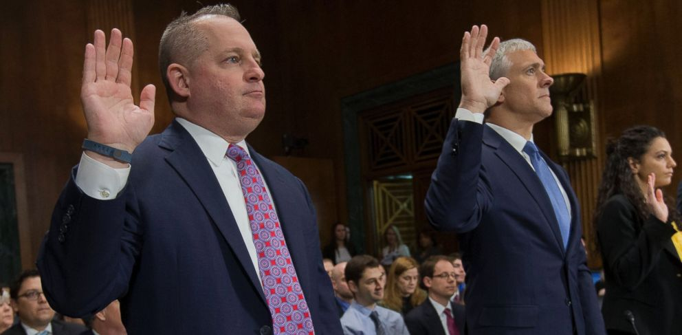 PHOTO: John J. Mulligan, left, executive Vice President and CFO of the Target Corporation, and, right, Michael R. Kingston, senior Vice President and CFO of the Neiman Marcus Group are sworn-in on Capitol Hill, Feb. 4, 2014, in Washington.