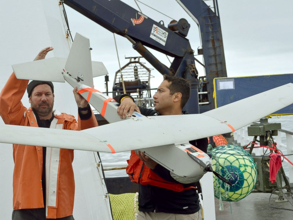 PHOTO: Shad Babb, left, and Armando Alvarado prepare to launch an unmanned aircraft from the deck of the Arctic Explorer, a commercial fishing boat, near Bishop Point on Unalaska Island, Alaska, in this June 14, 2011, file photo.