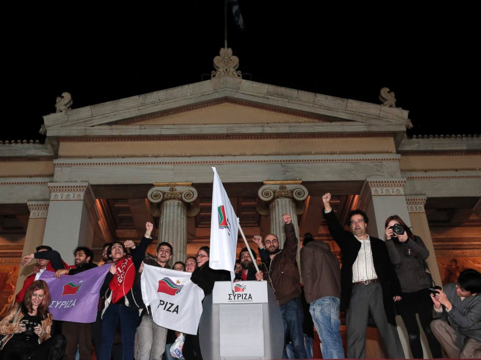 PHOTO: Supporters of the left-wing Syriza party Alexis Tsipras gather outside Athens University Headquarters, Jan. 25, 2015.
