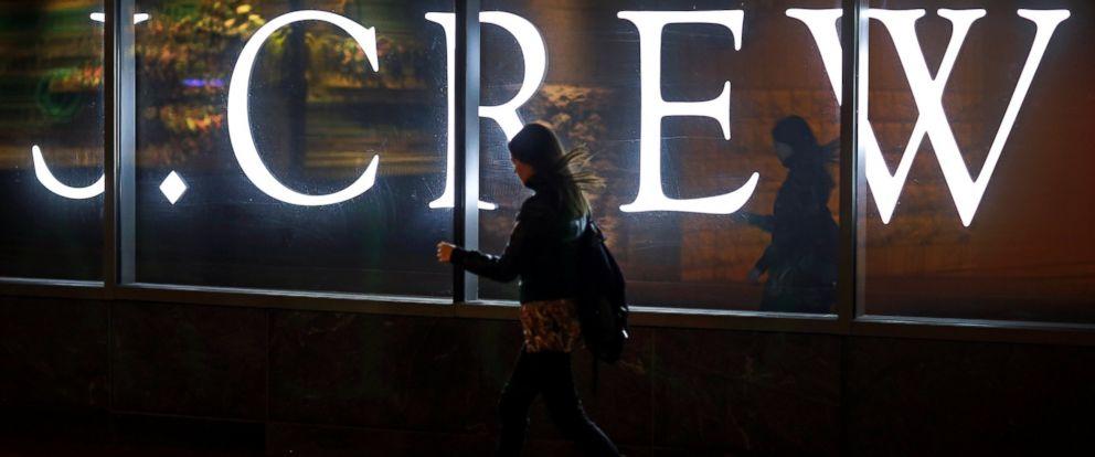 PHOTO: A woman walks past a J. Crew retail store in Baltimore, April 15, 2013.