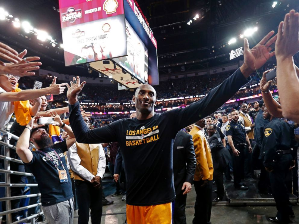 Los Angeles Lakers forward Kobe Bryant greets fans as he leaves the court after the teams NBA basketball game against the New Orleans Pelicans in New Orleans, April 8, 2016.