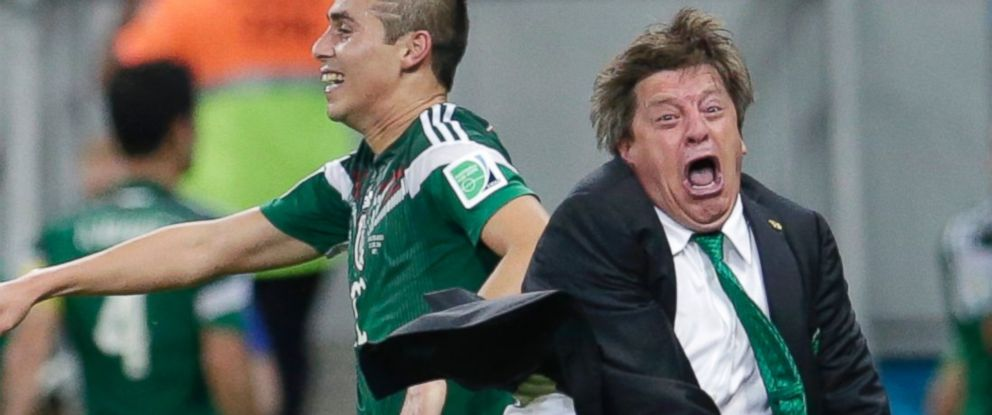 PHOTO: Mexicos head coach Miguel Herrera celebrates after Mexicos Andres Guardado scored his sides second goal during the group A World Cup soccer match between Croatia and Mexico at the Arena Pernambuco in Recife, Brazil, June 23, 2014.