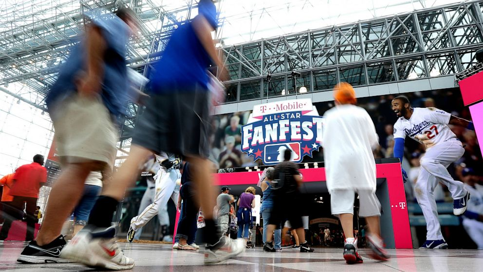 People walk into New York's Javits Convention Center during the All-Star FanFest, July 13, 2013.