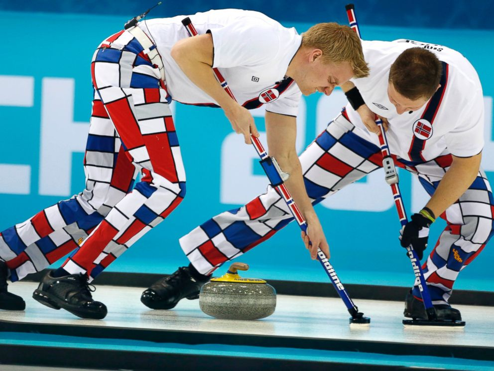 PHOTO: Norways Haavard Vad Petersson, left, and Christoffer Svae sweep during mens curling competition against Team USA at the 2014 Winter Olympics, Feb. 10, 2014, in Sochi, Russia.