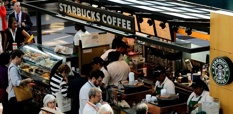 PHOTO: Customers line up at a Starbucks Coffee in New York, May 30, 2013.