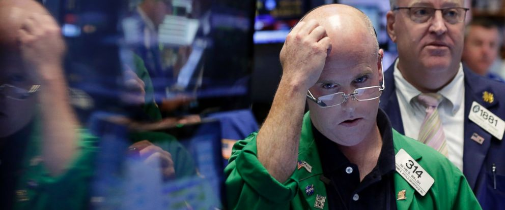 PHOTO: Trader Kevin Walsh, second from right, works on the floor of the New York Stock Exchange, June 24, 2016.