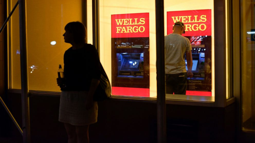 A customer uses a Wells Fargo bank ATM in New York, Sept. 21, 2016. Regulators alleged Wells Fargo employees opened millions of unauthorized accounts, transferred customers' money into them, and even signed people up for online banking in a feverish drive to meet sales targets.