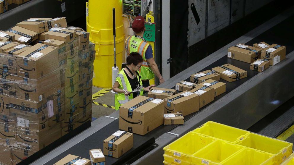 Packages move down a conveyor system to the proper shipping area at the new Amazon Fulfillment Center in Sacramento, Calif. on Feb. 9, 2018.