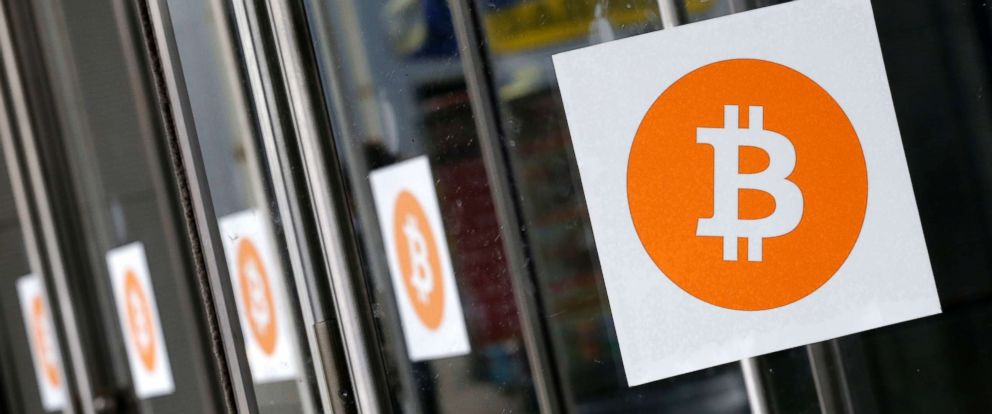 PHOTO: Bitcoin logos are displayed at the Inside Bitcoins conference and trade show, on April 7, 2014 in New York.