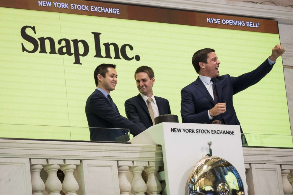 PHOTO: From left, Snapchat co-founders Bobby Murphy, chief technology officer of Snap Inc., and Evan Spiegel, chief executive officer of Snap Inc., ring the opening bell as Thomas Farley, president of the NYSE, looks on, March 2, 2017, in New York.