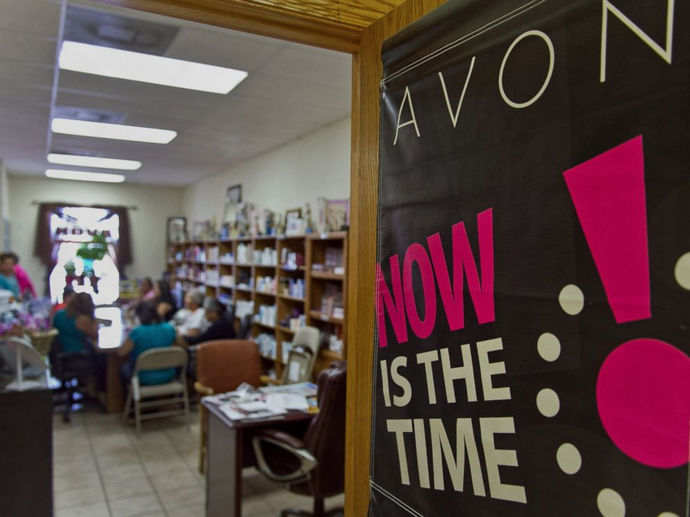 PHOTO: Avon Products Inc. signage is displayed on a door during a weekly sales meeting on Aug. 28, 2014 in McAllen, Texas.