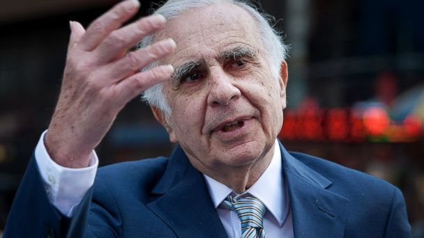 PHOTO: Carl Icahn, billionaire investor and chairman of Icahn Enterprises Holdings LP, talks outside of the Nasdaq MarketSite in New York, March 27, 2012.