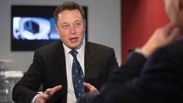 PHOTO: Elon Musk, billionaire, co-founder and chief executive officer of Tesla Motors Inc., gestures during an interview inside the Tesla store at Westfield Stratford City retail complex in London, Oct. 24, 2013.
