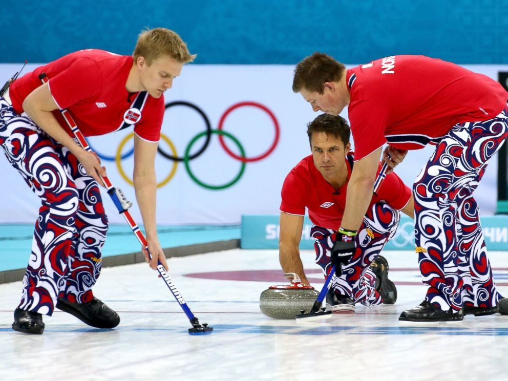 PHOTO: Jaavard Vad Petersson, Thomas Ulsrud and Christoffer Svae of Norway compete against Denmark during the Mens Curling Round Robin on Feb. 17, 2014.