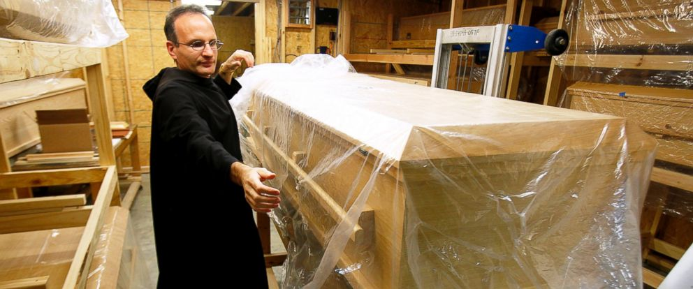 PHOTO: Brother Emmanuel Labrise of St. Josephs Abbey prepares a casket for lining in 2012 in Covington, Louisiana.