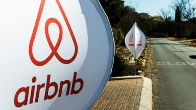 PHOTO: The logos of Airbnb Inc. sit on banners displayed outside a media event in Johannesburg, South Africa, July 27, 2015.