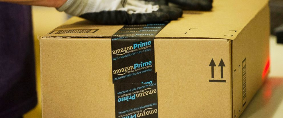 PHOTO: An employee seals a box at the Amazon.com Inc. fulfillment center in Phoenix, Ariz. on Dec. 2, 2013.