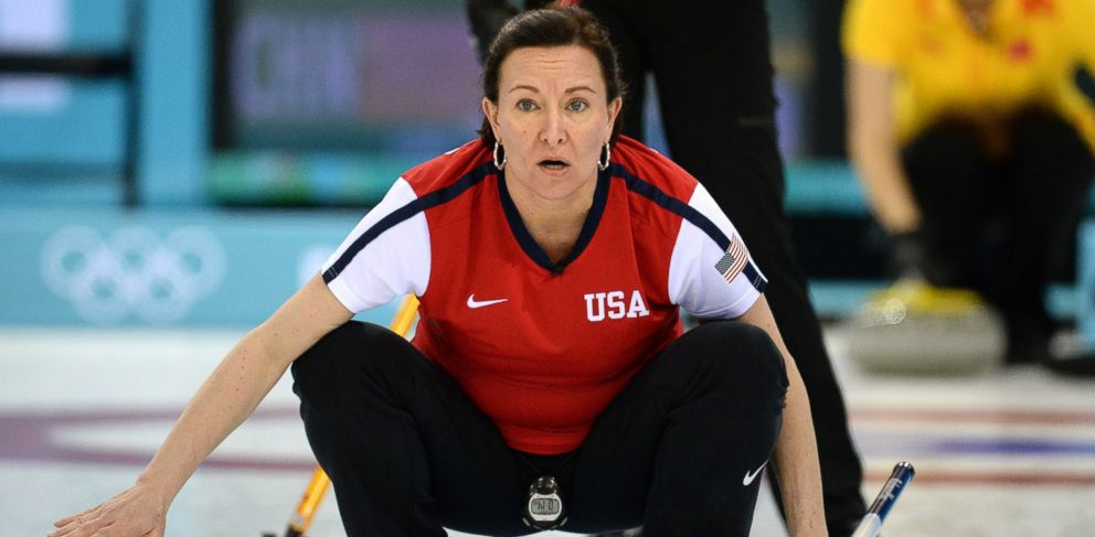 PHOTO: Ann Swisshelm reacts as she throws the stone during the womens curling round robin session 4 match against China at the Ice Cube curling centre in Sochi, Feb. 12, 2014.
