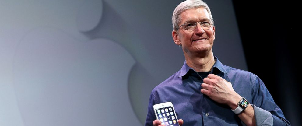 PHOTO: Apple CEO Tim Cook shows off the new iPhone 6 and the Apple Watch during an Apple special event at the Flint Center for the Performing Arts, Sept. 9, 2014, in Cupertino, Calif.