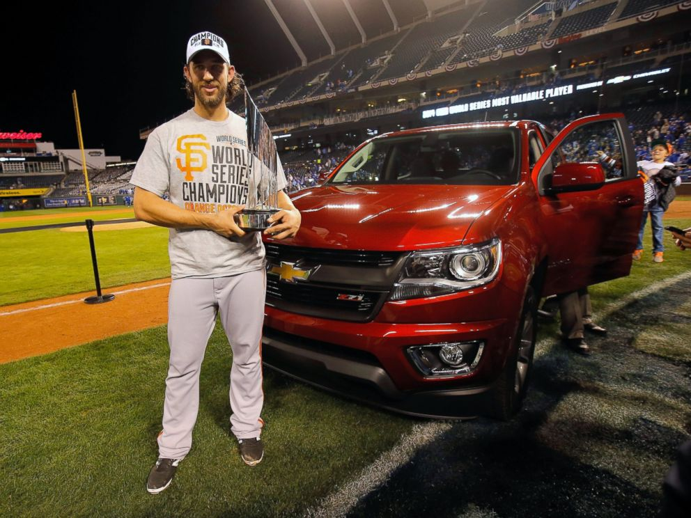 PHOTO: Madison Bumgarner holds the MVP trophy following a 3-2 victory over the Kansas City Royals in Game Seven of the 2014 World Series at Kauffman Stadium, Oct. 29, 2014, in Kansas City, Mo.