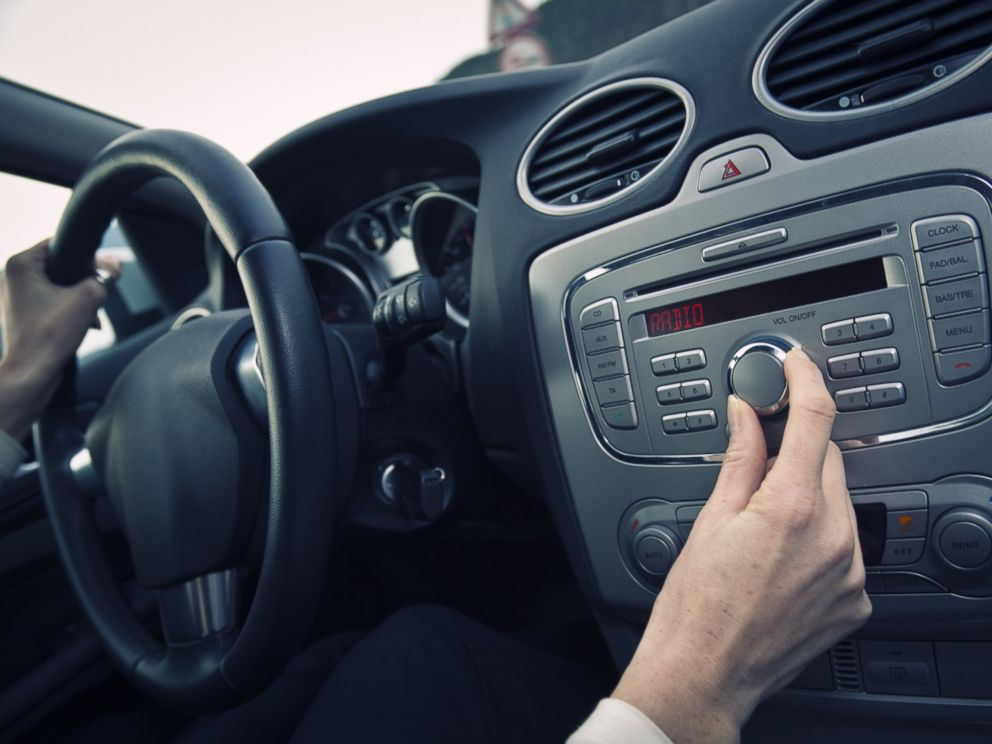 PHOTO: A man adjust the volume of a car stereo in this stock image.