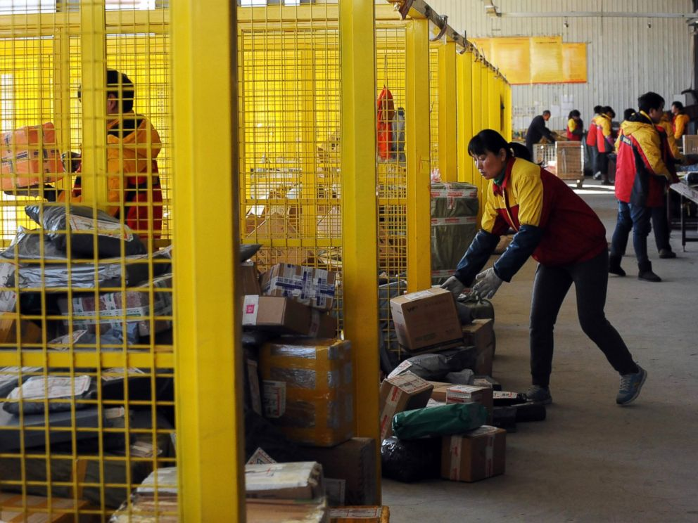 PHOTO: Workers sort out packages at an express delivery company in Beijing, Nov. 12, 2013, after Singles Day e-tailer festival on Nov. 11.