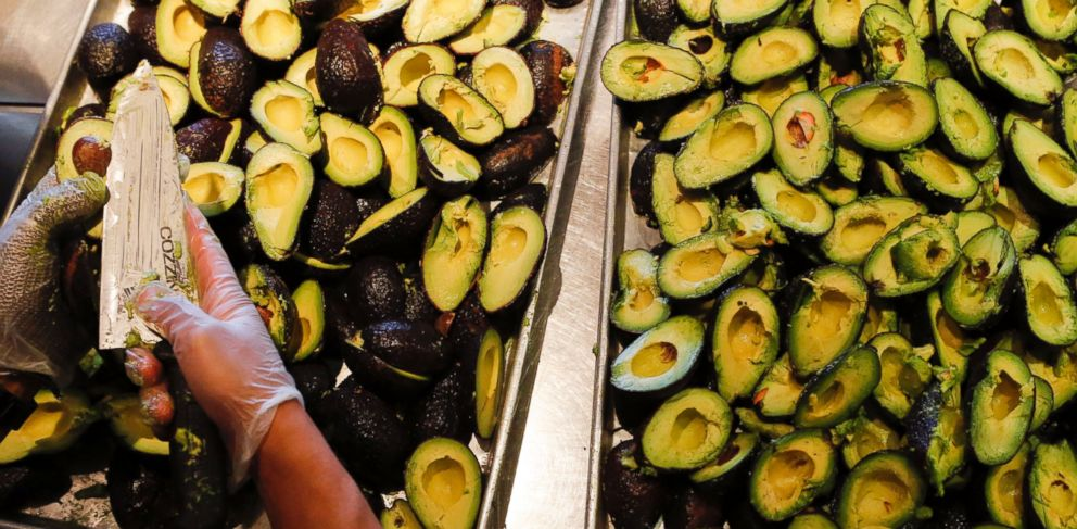 PHOTO: In this file photo, an employee slices avocados to be made into fresh guacamole at a Chipotle restaurant in Hollywood, Calif. on July 16, 2013.