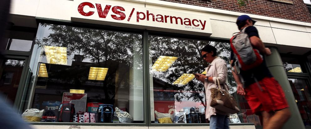 PHOTO: People walk past a CVS store in Manhattan, May 21, 2015, in New York.