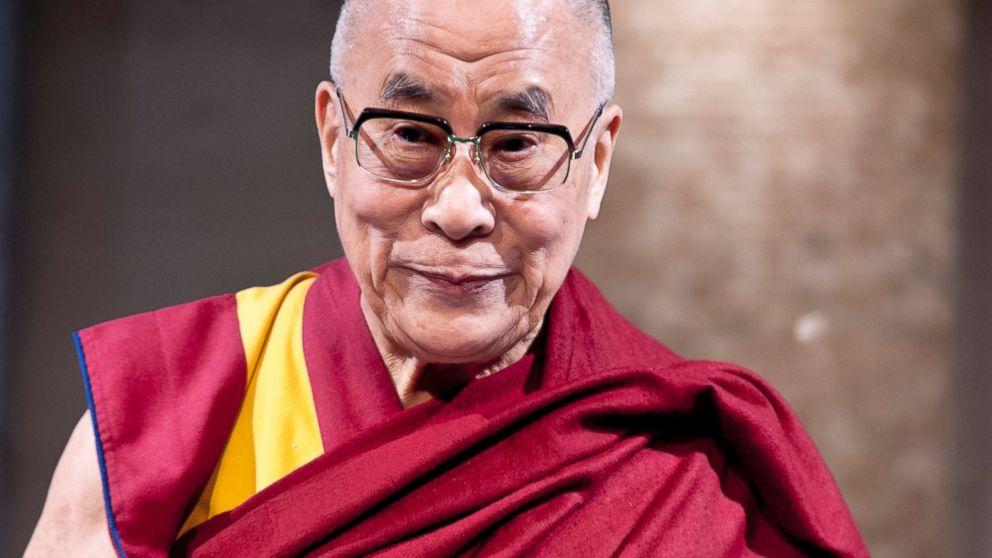 "Tibetan spiritual leader the Dalai Lama is introduced to guests during ""Dialogue in Tokyo"" at Hotel Okura in Tokyo, Nov. 17, 2013."