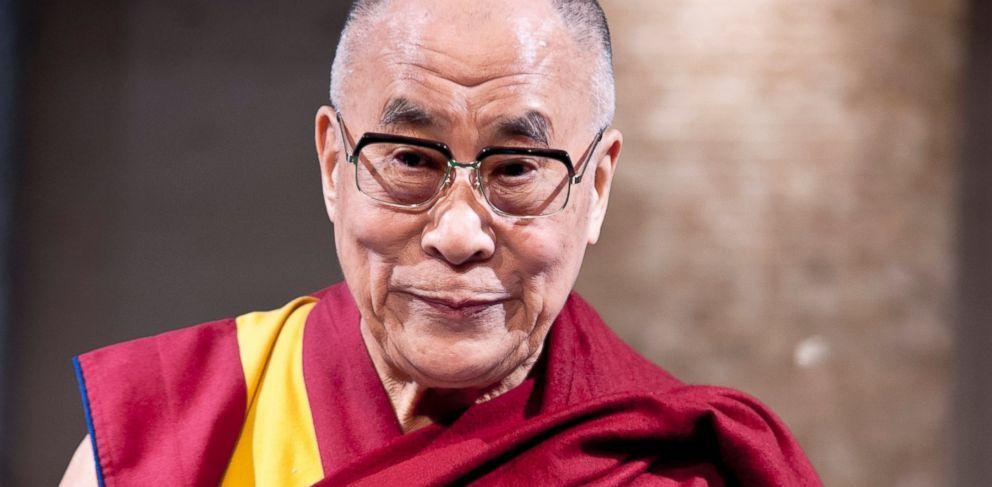 "PHOTO: Tibetan spiritual leader the Dalai Lama is introduced to guests during ""Dialogue in Tokyo"" at Hotel Okura in Tokyo, Nov. 17, 2013."