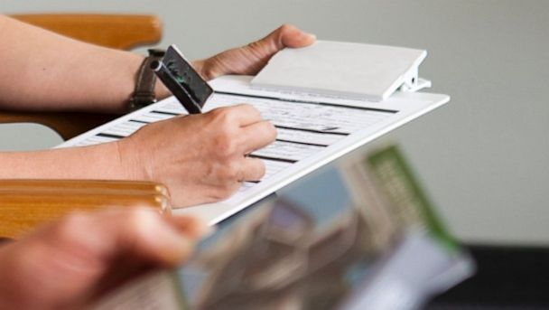 PHOTO: A patient fills out a health insurance form at a doctors office in this file photo.