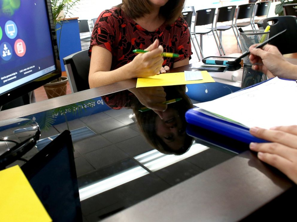 PHOTO: A Florida woman looks to purchase an insurance policy under the Affordable Care Act at the store setup in the Westland Mall in Hialeah, Fla., Nov. 14, 2013.