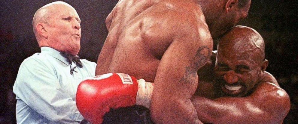 PHOTO: Referee Lane Mills steps in as Evander Holyfield winces after Mike Tyson bit his ear
