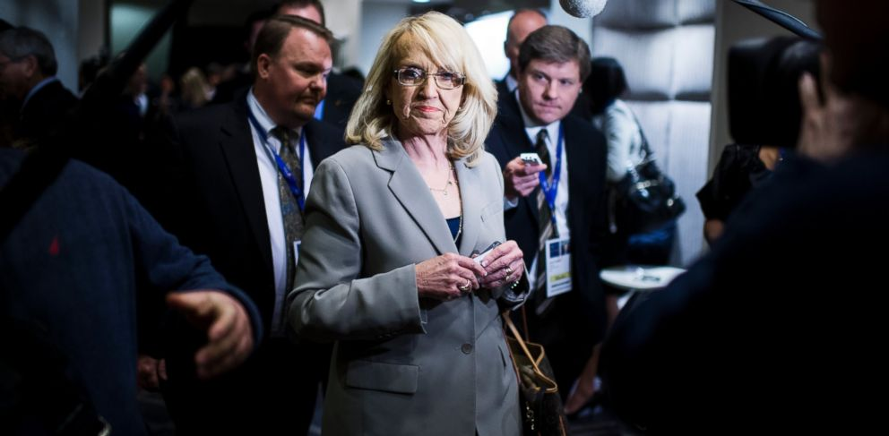 PHOTO: Cameras follow Arizona Governor Jan Brewer as she walks through the National Governors Association Winter Meeting at the JW Marriott in Washington, Feb. 22, 2014.